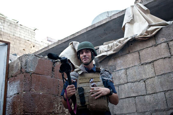 This photo posted on the website freejamesfoley.org shows journalist James Foley in Aleppo, Syria, in November, 2012. The family of an American journalist says he went missing in Syria more than one month ago while covering the civil war there. A statement released online Wednesday by the family of James Foley said he was kidnapped in northwest Syria by unknown gunmen on Thanksgiving day. (AP Photo/Nicole Tung, freejamesfoley.org) NO SALES