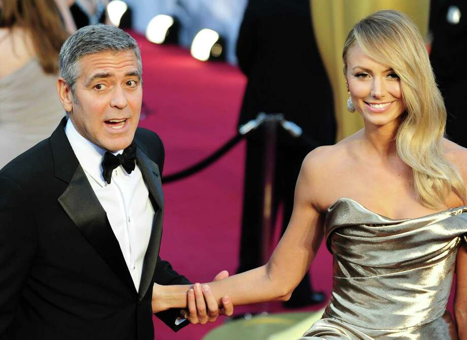 George Clooney, 51, and girlfriend Stacy Keibler, 32, at the Academy Awards in 2012.  Photo: FREDERIC J. BROWN, AFP/Getty Images / 2012 AFP