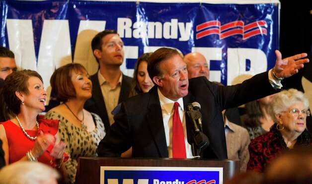 Newly-elected Republican candidate Randy Weber gives his victory speech as his wife Brenda, left, looks on at the South Shore Harbor Resort and Conference Center on Tuesday, Nov. 6, 2012, in League City, Texas. Weber defeated Democratic candidate Demoractic Nick Lampson for the 14th Congressional District. (AP Photo/Houston Chronicle, J. Patric Schneider) MANDATORY CREDIT Photo: CHRON, MBI / Houston Chronicle