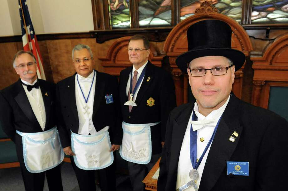 Worshipful Master Alex B. Smuckler, right, poses with members of St. George's Lodge No. 6 Free and Accepted Masons of Schenectady on Tuesday, Dec. 18, 2012, at the Schenectady Masonic Temple in Rotterdam, N.Y. Members, from left, are historian Francis I. Karwowski, treasurer and past master Ronald C. Edmonson and past grand director of ceremonies Henry Michelin. (Cindy Schultz / Times Union) Photo: Cindy Schultz / 00020505A