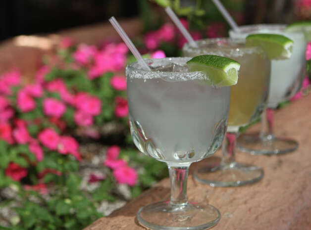 Margarita on the rocks instead of frozen: Few things go down better with a plate of enchiladas or an order of fajitas than a cold margarita, but think twice before ordering that frozen concoction. The frozen version contains more than 400 calories, while a margarita on the rocks contains 170 calories. The difference is the syrupy sweet and sour mix that often goes into margarita machines. Photo: HELEN L. MONTOYA, SAN ANTONIO EXPRESS-NEWS / hmontoya@express-news.net