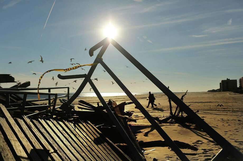 Boardwalk debris lies along the beach Wednesday in the Queens borough of New York City, some nine weeks after the havoc caused by Superstorm Sandy. Photo: Spencer Platt, Staff / 2013 Getty Images