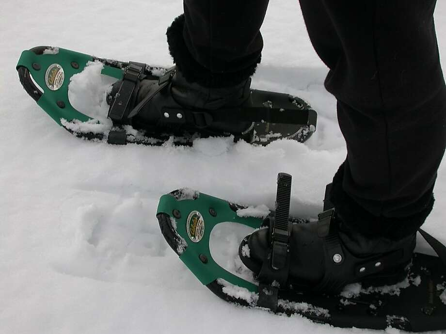 Standard snowshoes for powder snow. For deep powder, wear large snowshoes to keep from post holing. For ice, instead wear YaxTrax. For ice on slopes, wear crampons. Photo: Tom Stienstra, The Chronicle