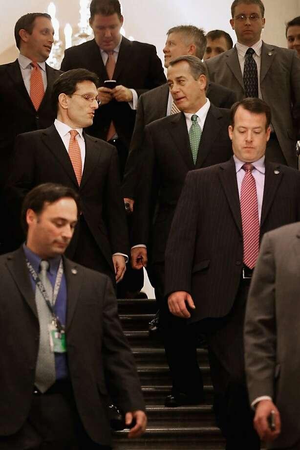 House Majority Leader Eric Cantor (left), R-Va., opposed the law, while Speaker John Boehner, R-Ohio, voted for it. Photo: Chip Somodevilla, Getty Images