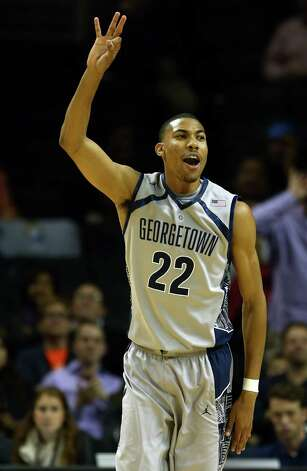 NEW YORK, NY - NOVEMBER 19: Otto Porter #22 of the Georgetown Hoyas celebrates his three point shot in the second half against the UCLA Bruins  during the Legends Classic on November 19, 2012 at the Barclays Center in the Brooklyn borough of New York City. The Georgetown Hoyas defeated the UCLA Bruins 78-70.  (Photo by Elsa/Getty Images) Photo: Elsa, Getty Images / 2012 Getty Images