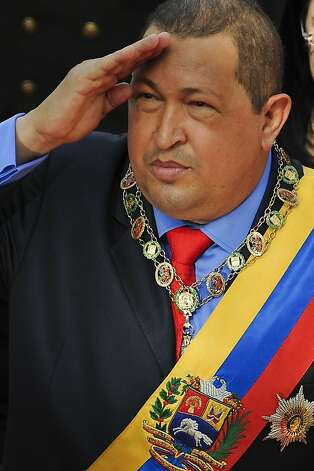 (FILE) Venezuelan President Hugo Chavez salutes military-style before the Parliament in Caracas on January 13, 2012 during his annual report about the actions and accomplishments of his government. Chavez condition is delicate but stable said his son-in-law the Minister of Science and Technology Jorge Arreaza in Havana on January 2nd, 2013.  AFP PHOTO/Leo RAMIREZLEO RAMIREZ/AFP/Getty Images Photo: Leo Ramirez, AFP/Getty Images