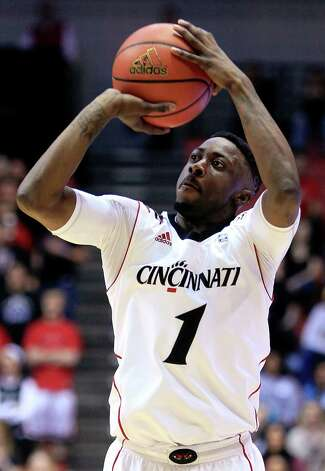 Cincinnati guard Cashmere Wright shoots a three-pointer against Maryland Eastern Shore in the first half of an NCAA college basketball game, Saturday, Dec. 8, 2012, in Cincinnati. (AP Photo/Al Behrman) Photo: Al Behrman, Associated Press / AP