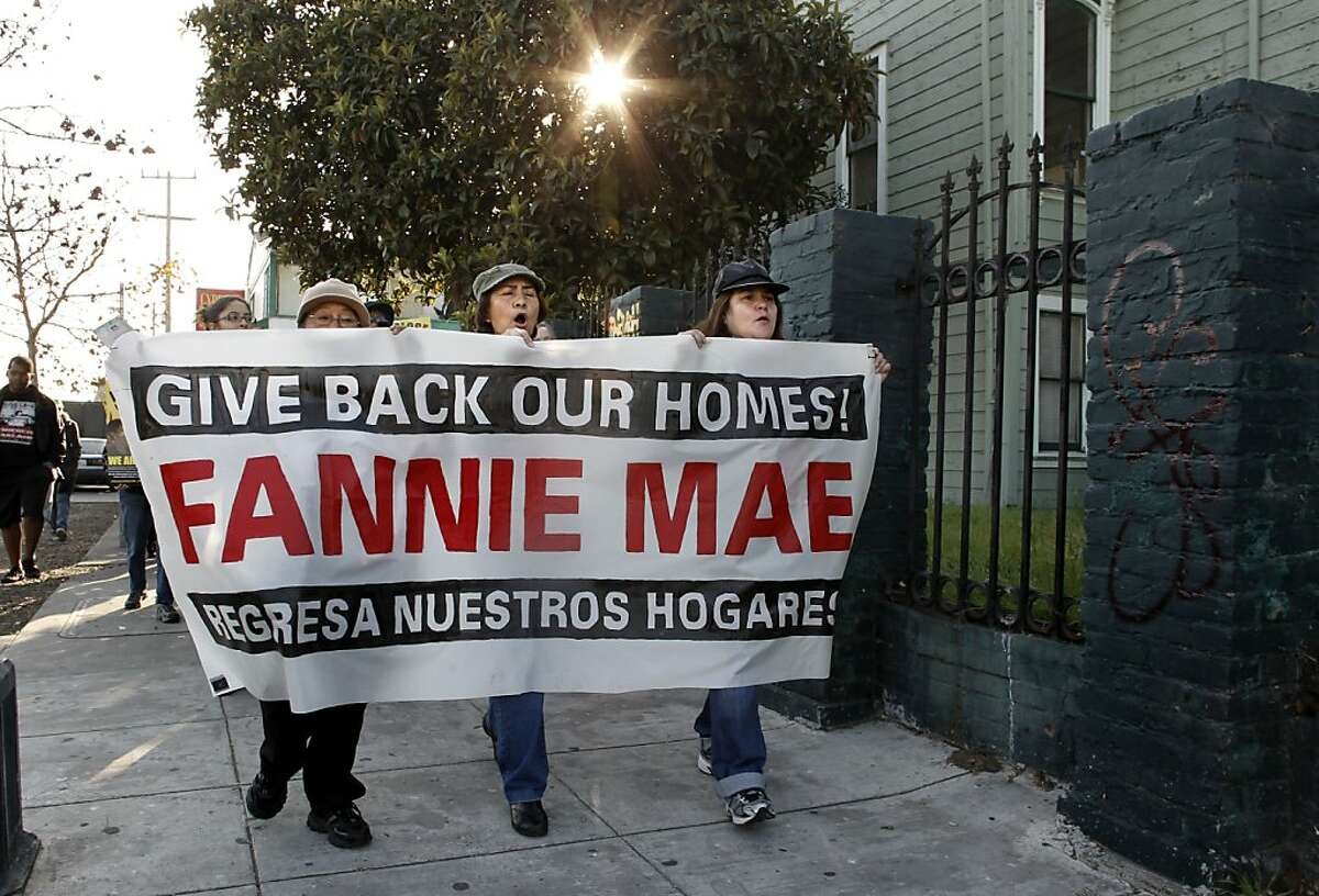Supporters march along Mandela Parkway enroute to a vacant home that they plan on occupying at 1415 10th street , in West Oakland, Ca., on Tuesday December 6, 2011. The group Occupy Oakland and members of Just Cause join the national day of action called,