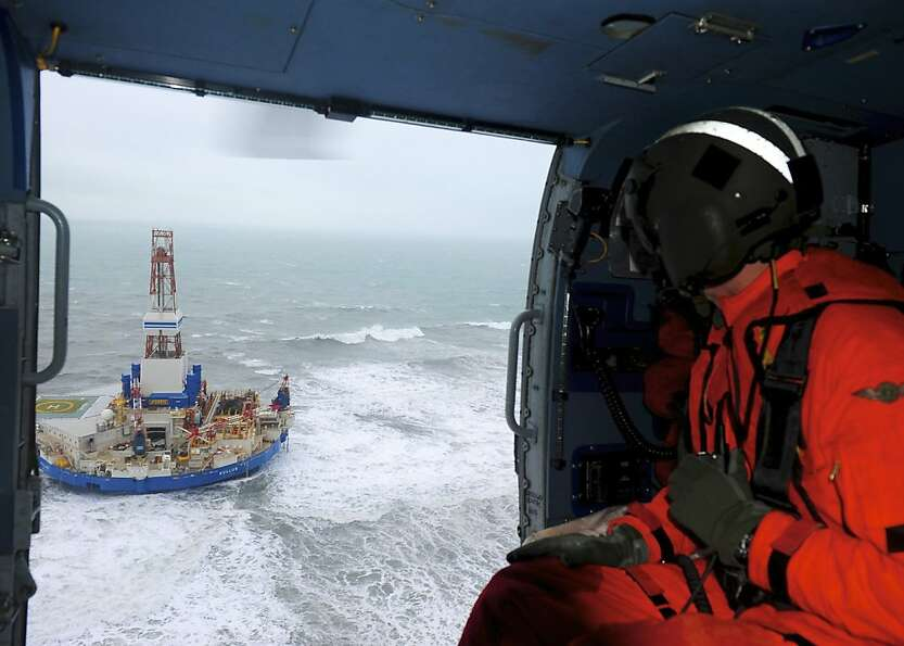 Rear Adm. Thomas Ostebo gets an aerial view of the Shell rig that ran aground Monday night.