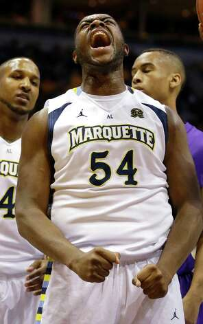 Marquette's Davante Gardner (54) reacts after scoring against LSU during the first half of an NCAA college basketball game, Saturday, Dec. 22, 2012, in Milwaukee. (AP Photo/Jeffrey Phelps) Photo: Jeffrey Phelps, Associated Press / FR59249 AP