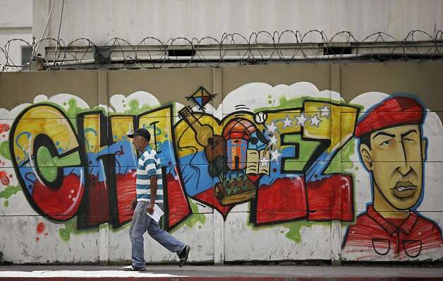 A mural in Caracas, Venezuela, honors President Hugo Chavez, who is undergoing cancer treatment in Cuba. Photo: Ariana Cubillos, Associated Press