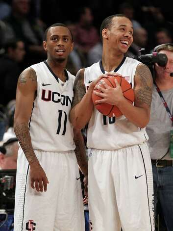 NEW YORK, NY - MARCH 06:  Ryan Boatright #11 and Shabazz Napier #13 of the Connecticut Huskies celebrate after defeating the DePaul Blue Demons during their first round game of the 2012 Big East Men's Basketball Tournament at Madison Square Garden on March 6, 2012 in New York City.  (Photo by Jim McIsaac/Getty Images) Photo: Jim McIsaac, Getty Images / 2012 Getty Images