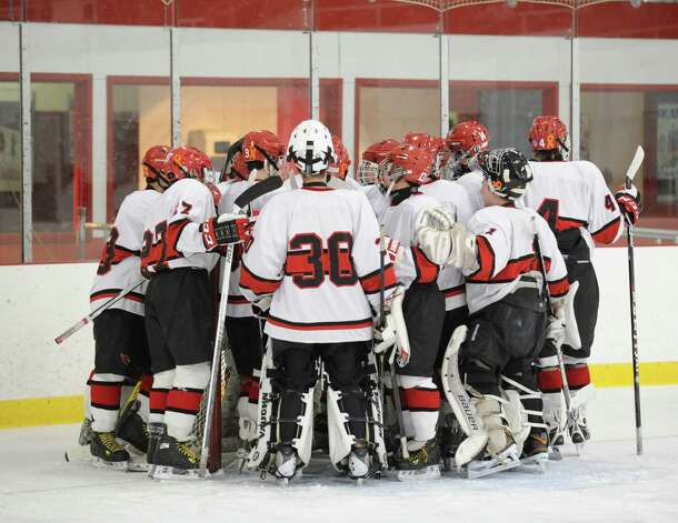 The Greenwich High School boys hockey team huddles before the game against Xavier of Middletown, Conn., at Dorothy Hamill Rink, Wednesday night, Jan. 2, 2013. Photo: Bob Luckey / Greenwich Time