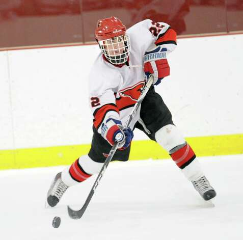 Decker Curran # 22 of Greenwich shoots the puck during the boys high school hockey game between Greenwich and Xavier of Middletown, Conn., at Dorothy Hamill Rink, Wednesday night, Jan. 2, 2013. Photo: Bob Luckey / Greenwich Time