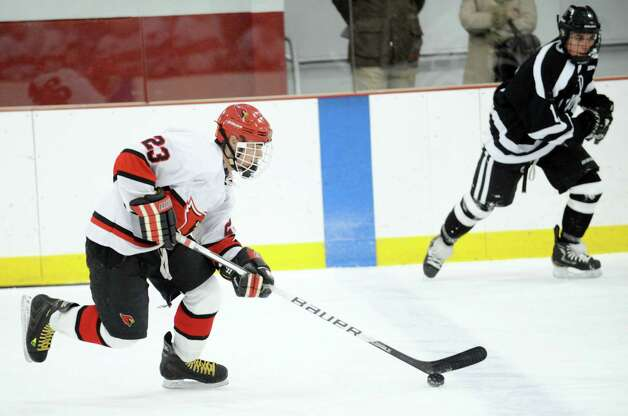 Matt Lodato # 23 of Greenwich advances the puck during first period action of the boys high school hockey game between Greenwich and Xavier of Middletown, Conn., at Dorothy Hamill Rink, Wednesday night, Jan. 2, 2013. Photo: Bob Luckey / Greenwich Time