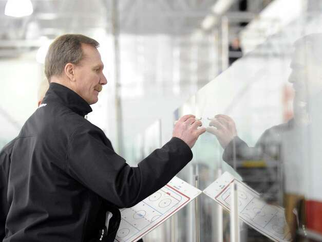 Greenwich High School boys hockey coach Bob Russel diagrams a play during the game between Greenwich and Xavier of Middletown, Conn., at Dorothy Hamill Rink, Wednesday night, Jan. 2, 2013. Photo: Bob Luckey / Greenwich Time