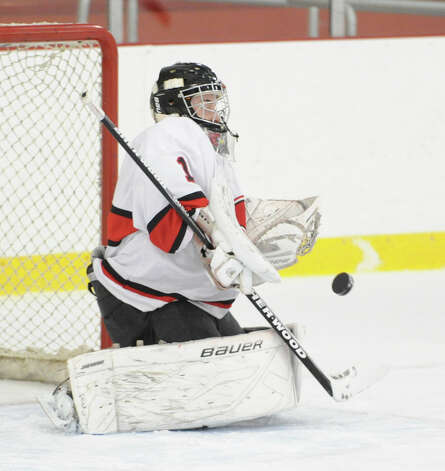 Greenwich goalie Bryan Archino blocks a shot during the boys high school hockey game between Greenwich and Xavier of Middletown, Conn., at Dorothy Hamill Rink, Wednesday night, Jan. 2, 2013. Photo: Bob Luckey / Greenwich Time