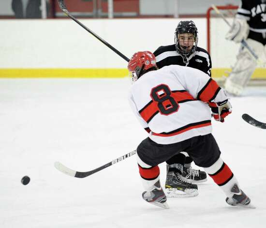 Mark Schmeiler # 8 of Greenwich passes the puck to a teammate during first period action of the boys high school hockey game between Greenwich and Xavier of Middletown, Conn., at Dorothy Hamill Rink, Wednesday night, Jan. 2, 2013. Photo: Bob Luckey / Greenwich Time