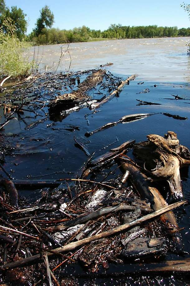 Oil washes up on the banks of the Yellowstone River near Laurel, Mont., after a pipeline break in July 2011. Photo: Matthew Brown, Associated Press