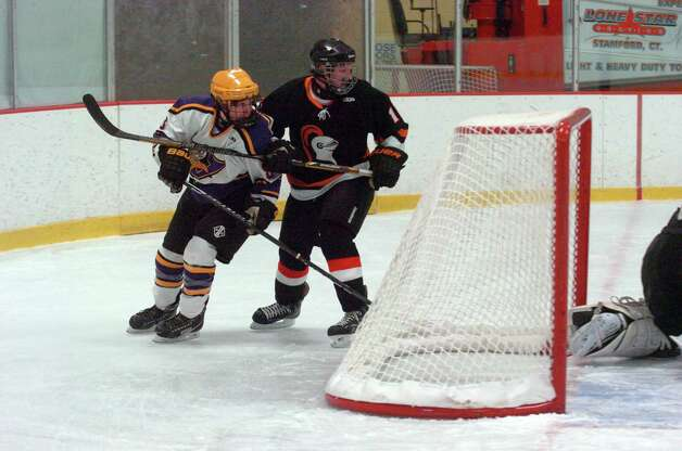 Stamford's Ryan Palmer and Westhill's Ryan Silk in action as Stamford and Westhill HIgh Schools face off in a boys hockey game at Terry Conners Ice Rink in Stamford, Conn., Jan. 2, 2012. Photo: Keelin Daly / Stamford Advocate Riverbend Stamford, CT