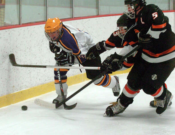 Westhill's Dan Rotkewicz moves along the boards as Stamford and Westhill HIgh Schools face off in a boys hockey game at Terry Conners Ice Rink in Stamford, Conn., Jan. 2, 2012. Photo: Keelin Daly / Stamford Advocate Riverbend Stamford, CT