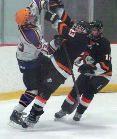 Westhill's Scott Reville and Stamford's Carter Trabakino, right, collide as Stamford and Westhill HIgh Schools face off in a boys hockey game at Terry Conners Ice Rink in Stamford, Conn., Jan. 2, 2012. Photo: Keelin Daly / Stamford Advocate Riverbend Stamford, CT