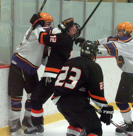 Westhill's Scott Reville and Stamford's Ryan Palmer, right, battle as Stamford and Westhill HIgh Schools face off in a boys hockey game at Terry Conners Ice Rink in Stamford, Conn., Jan. 2, 2012. Photo: Keelin Daly / Stamford Advocate Riverbend Stamford, CT