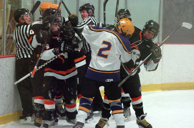 Some fisticuffs as Stamford and Westhill HIgh Schools face off in a boys hockey game at Terry Conners Ice Rink in Stamford, Conn., Jan. 2, 2012. Photo: Keelin Daly / Stamford Advocate Riverbend Stamford, CT
