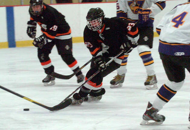 Stamford's Carter Trabakino cuts through the Westhill defense as Stamford and Westhill HIgh Schools face off in a boys hockey game at Terry Conners Ice Rink in Stamford, Conn., Jan. 2, 2012. Photo: Keelin Daly / Stamford Advocate Riverbend Stamford, CT