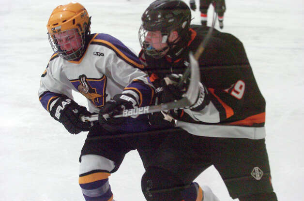 Stamford's Tim Walsh and Westhill's Jeff Kurzman collide as Stamford and Westhill HIgh Schools face off in a boys hockey game at Terry Conners Ice Rink in Stamford, Conn., Jan. 2, 2012. Photo: Keelin Daly / Stamford Advocate Riverbend Stamford, CT