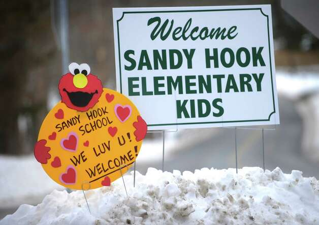 Signs at the intersection of Fan Hill Road and Hammertown Road in Monroe welcome Sandy Hook Elementary School students to the reopened Chalk Hill School on Wednesday, January 2, 2012. Photo: Brian A. Pounds