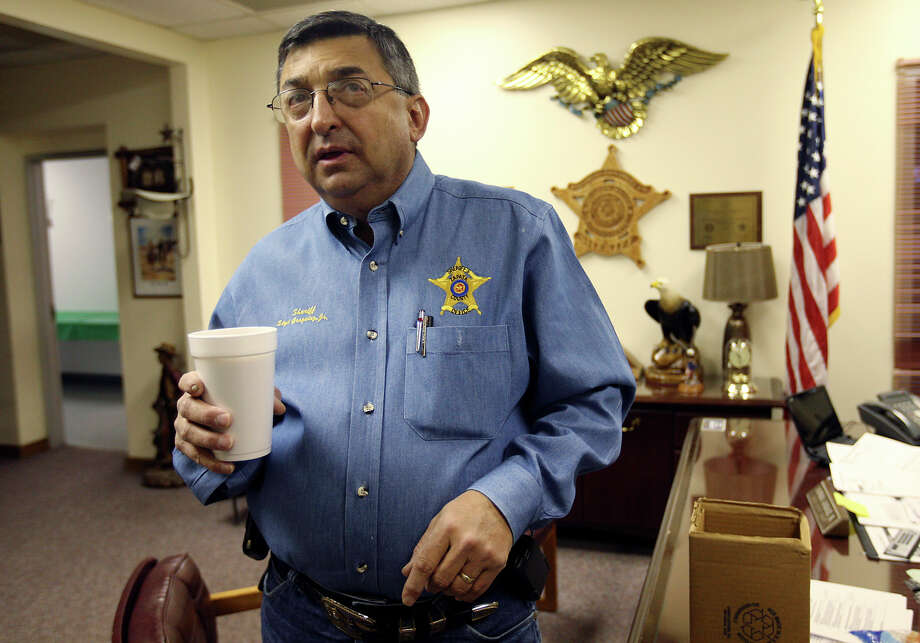 Zapata County Sheriff Sigifredo Gonzalez, Jr. looks around his office Thursday, Dec. 13, 2012. Gonzalez will retire at the end of the year after nearly 19 years in office. One of his accomplishments was helping found the Texas Border Sheriffs Coalition, an advocacy organization that gave rise to the Southwestern Border Sheriffs Coalition. The two organizations bring attention to border security issues, organize for law enforcement officials to testify before state legislatures and Congress and administer grants to border agencies. Photo: Jerry Lara, Staff / © 2012 San Antonio Express-News