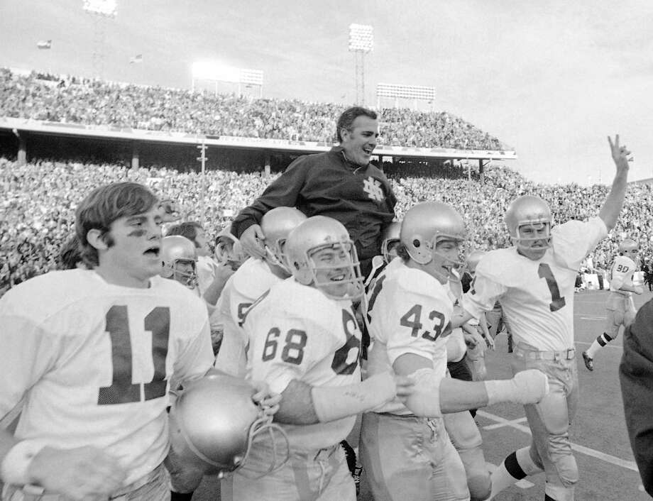 FILE - In this Jan. 1, 1971, file photo, Notre Dame coach Ara Parseghian is carried off the field by his victorious players after the Irish victory over Texas 24-11 in the Cotton Bowl NCAA college football game in Dallas. At a time when college football was generally considered the domain of eastern blue bloods, Notre Dame and Alabama were upstart teams that gave blue collar fans a chance to tweak the elite. About 90 years later, the Fighting Irish and Crimson Tide are the elite - two of college football's signature programs, set to play a national championship next Monday in Miami that could break records for television viewership. (AP Photo/File) Photo: Anonymous