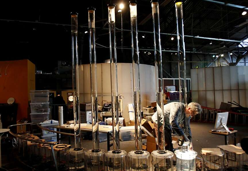 Charles Sowers, the artist who created the tidal memory exhibit, dismantles it so it can be moved to
