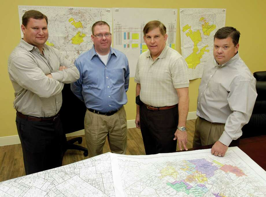 JBL Energy Partners Jason Lane, managing partner, left, John P. Gilliland, senior land manager,  Fred Hoffman, geologist, and Matt MacEachern, land manager,  and John Gilliland, senior landman, right, poses in the office Thursday, Nov. 15, 2012, in Tomball. Photo: Melissa Phillip, Staff / © 2012 Houston Chronicle