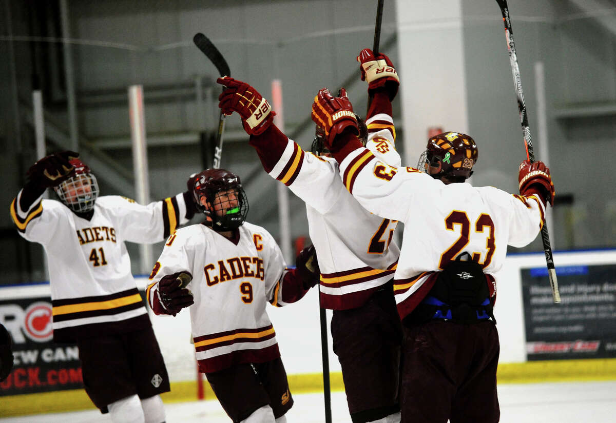 Teammates rush in to celebrate after St. Joseph's #25 Andrew Gore, center, scored a tie breaking goal against South Windsor in the third quarter, during boys hockey action at The Rinks in Shelton, Conn. on Wednesday January 2, 2012.