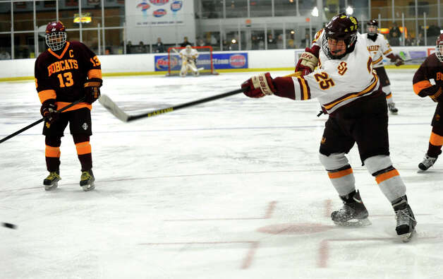 St. Joseph's #25 Andrew Gore follows through on a slap shot goal attempt against South Windsor, during boys hockey action at The Rinks in Shelton, Conn. on Wednesday January 2, 2012. Photo: Christian Abraham / Connecticut Post