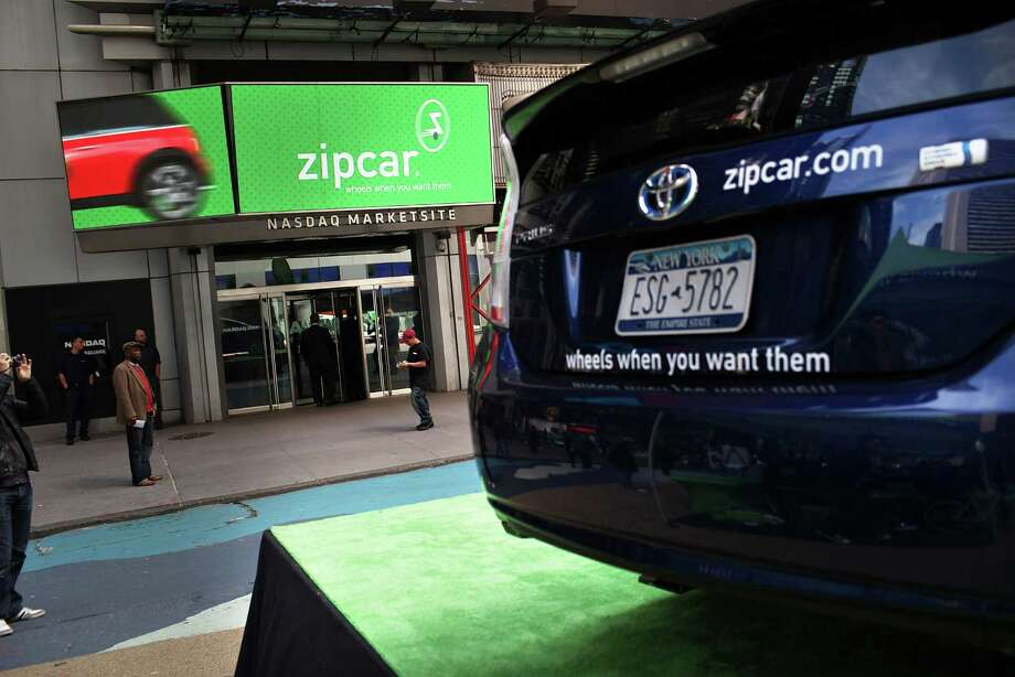 In this file photo, a Zipcar is displayed during a promotion in Times Square in New York City. Avis agreed to buy Zipcar for about $500 million. Photo: Spencer Platt, Getty Images / 2011 Getty Images