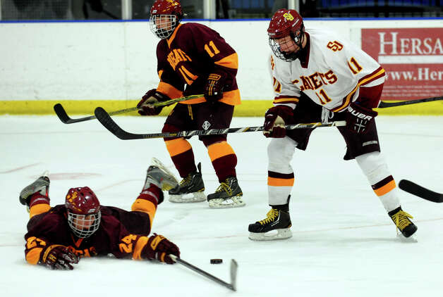 South Windsor's #24 Connor Hibbs slides in to block St. Joseph's #11 Sean Hurley from passing the puck, during boys hockey action at The Rinks in Shelton, Conn. on Wednesday January 2, 2012. Photo: Christian Abraham / Connecticut Post