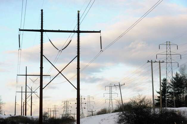Power transmission lines off Route 43 in North Greenbush, N.Y. Wednesday Jan. 2, 2013. (Michael P. Farrell/Times Union) National Grid is planning to increase spending to upgrade such lines over the next five years. Photo: Michael P. Farrell
