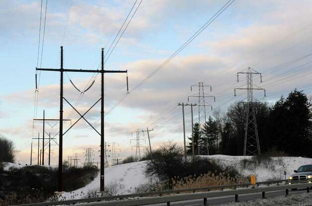 Power transmission lines off Route 43 in North Greenbush, N.Y. Wednesday Jan. 2, 2013. (Michael P. Farrell/Times Union) National Grid is planning to increase spending on upgrading such lines over the next five years. Photo: Michael P. Farrell