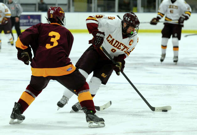 St. Joseph's #9 Christian Keator manuevers the puck around South Windsor's #3 Matt Bracci, during boys hockey action at The Rinks in Shelton, Conn. on Wednesday January 2, 2012. Photo: Christian Abraham / Connecticut Post
