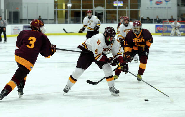 St. Joseph's #9 Christian Keator tries to move the puck around South Windsor's #3 Matt Bracci, during boys hockey action at The Rinks in Shelton, Conn. on Wednesday January 2, 2012. Photo: Christian Abraham / Connecticut Post