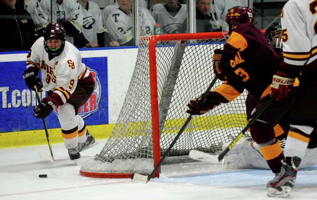 St. Joseph's #9 Christian Keator comes around South Windsor's goal with the puck, during boys hockey action at The Rinks in Shelton, Conn. on Wednesday January 2, 2012. Photo: Christian Abraham / Connecticut Post