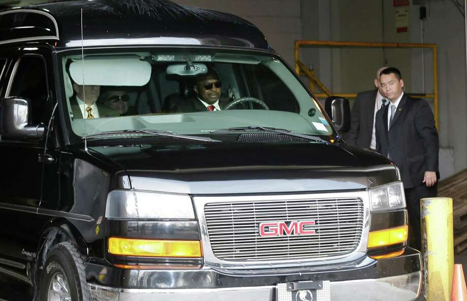 Secretary of State Hillary Clinton, center, is transported on the New York Presbyterian Hospital complex Wednesday, Jan. 2, 2013, in New York.  Officials say Clinton who was admitted to the New York hospital Sunday continues to be treated with blood thinners to dissolve a clot in the vein behind the right ear. Doctors found the clot during a follow-up exam stemming from a concussion she suffered in early December. (AP Photo/Frank Franklin II) Photo: Frank Franklin II