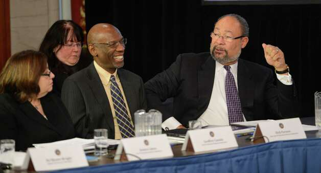 Jessica Cohen, left; Geoffrey Canada, center and Chairman Dick Parsons of the New N. Y. Education Reform Commission speak during a cabinet meeting in the State Capitol in Albany, N.Y. Jan 2, 2013.(Skip Dickstein/Times Union) Photo: SKIP DICKSTEIN / 00020630A
