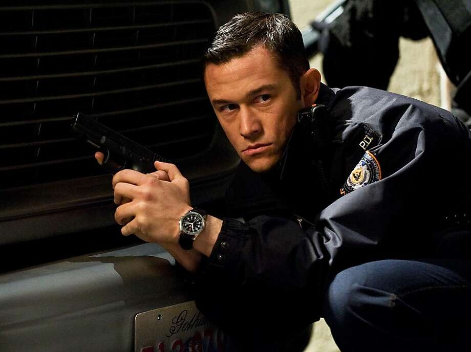 "Joseph Gordon-Levitt appeared in ""The Dark Knight Rises,"" an intensely violent movie. Photo: Ron Phillips, Associated Press"