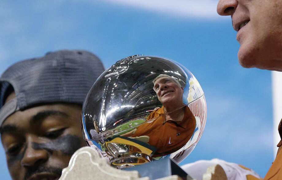 Mack Brown doesn't want Alamo Bowl trophies to be a reflection of his program. Photo: Eric Gay, STF / AP