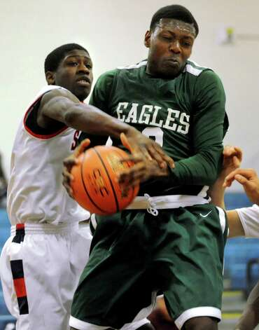 Green Tech's Jafari Coleman (3), right, grabs a rebound as Schenectady's Johnson Gooden-Prunty (23) defends during their basketball game on Thursday, Dec. 27, 2012, at Schenectady High in Schenectady, N.Y. (Cindy Schultz / Times Union) Photo: Cindy Schultz / 00020577A