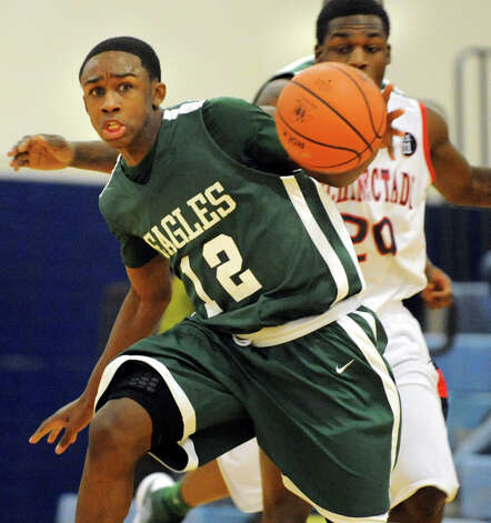 Green Tech's Jamil Hood Jr. (12), left, charges up court as Schenectady's Troy Garr (20) defends during their basketball game on Thursday, Dec. 27, 2012, at Schenectady High in Schenectady, N.Y. (Cindy Schultz / Times Union) Photo: Cindy Schultz